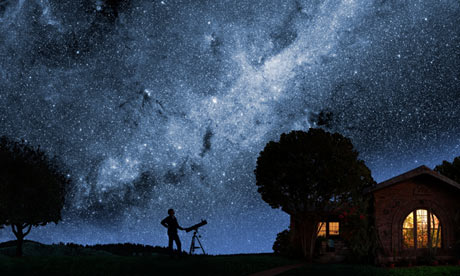 A man gazes at the Milky Way outside his house