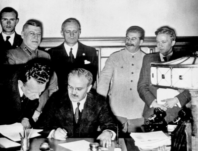 Joseph Stalin, second from the right, looks on as German and Soviet officials sign the non-aggression pact on August 23, 1939